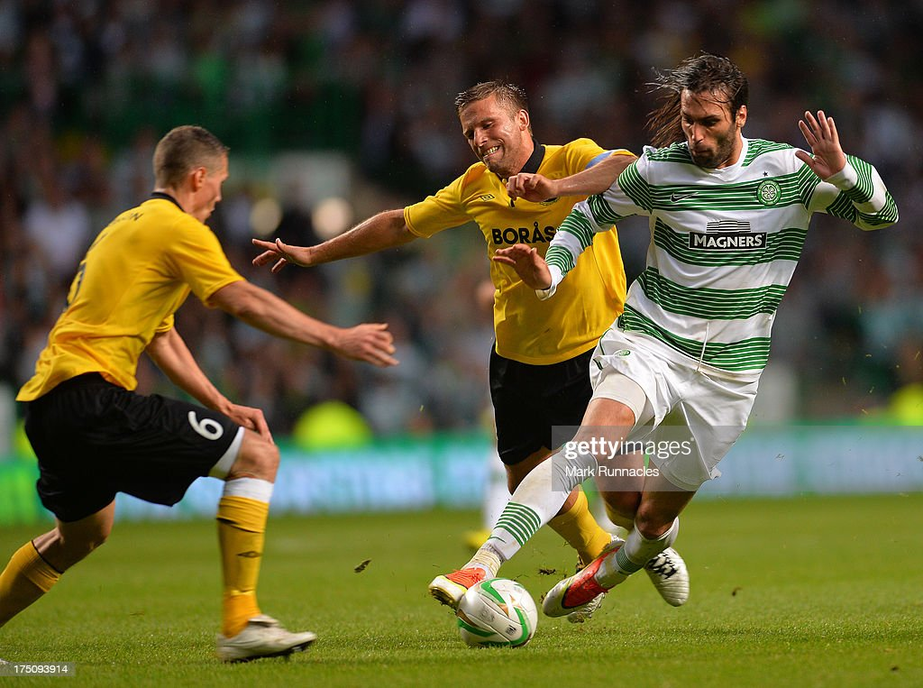 <a gi-track='captionPersonalityLinkClicked' href=/galleries/search?phrase=Georgios+Samaras&family=editorial&specificpeople=616608 ng-click='$event.stopPropagation()'>Georgios Samaras</a> of Celtic takes on <a gi-track='captionPersonalityLinkClicked' href=/galleries/search?phrase=Anders+Svensson&family=editorial&specificpeople=167083 ng-click='$event.stopPropagation()'>Anders Svensson</a> and Jon Jonsson of Elfsborg collide in midfield during the UEFA Champions League Third Qualifying Round First Leg match between Celtic and Elfsborg at Celtic Park Stadium on July 31, 2013 in Glasgow, Scotland.