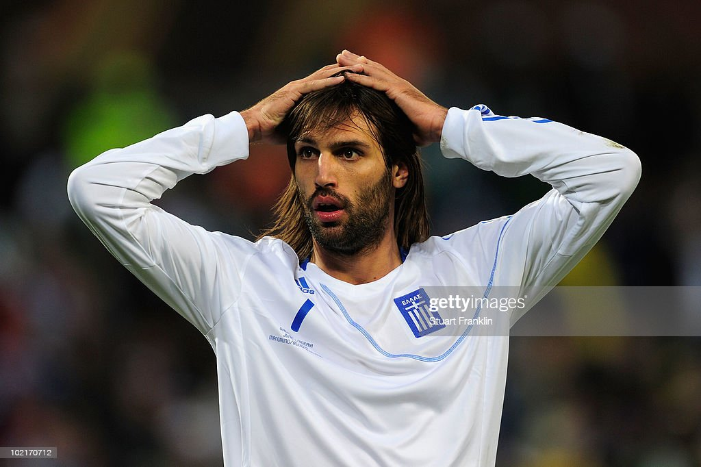 <a gi-track='captionPersonalityLinkClicked' href=/galleries/search?phrase=Georgios+Samaras&family=editorial&specificpeople=616608 ng-click='$event.stopPropagation()'>Georgios Samaras</a> of Greece reacts during the 2010 FIFA World Cup South Africa Group B match between Greece and Nigeria at the Free State Stadium on June 17, 2010 in Mangaung/Bloemfontein, South Africa.