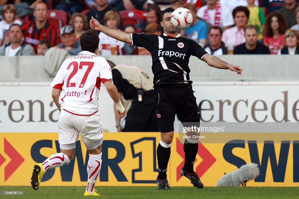Georgios Tzavellas of Frankfurt is challenged by Stefano Celozzi of Stuttgart during the Bundesliga match between VfB Stuttgart and Eintracht...