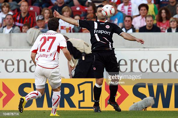 Georgios Tzavellas of Frankfurt is challenged by Stefano Celozzi of Stuttgart during the Bundesliga match between VfB Stuttgart and Eintracht...