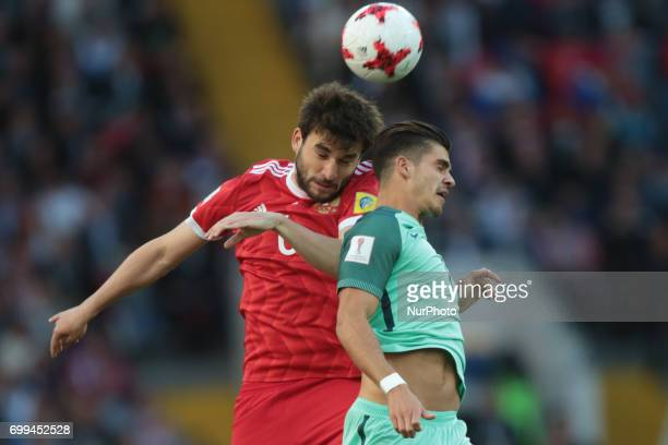 Georgiy Dzhikiya of the Russian national football team and André Silva of the Portugal national football team vie for the ball during the 2017 FIFA...