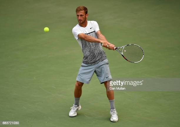 Georgiy Pochay of Turkmenistan plays a backhand against Filip Nikolic of Azerbaijan in the Mens Tennis Singles first round match during day five of...