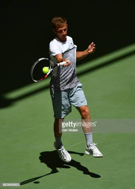Georgiy Pochay of Turkmenistan plays a forehand against Filip Nikolic of Azerbaijan in the Mens Tennis Singles first round match during day five of...