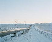 Geo-thermal pipeline by snowy road