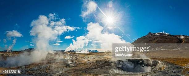 Geothermal steam rising over hot springs volcano panorama Hverir Iceland
