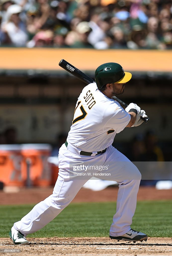 <a gi-track='captionPersonalityLinkClicked' href=/galleries/search?phrase=Geovany+Soto&family=editorial&specificpeople=743668 ng-click='$event.stopPropagation()'>Geovany Soto</a> #17 fo the Oakland Athletics hits a bases loaded two-run single against the Seattle Mariners in the bottom of the first inning at O.co Coliseum on September 1, 2014 in Oakland, California.