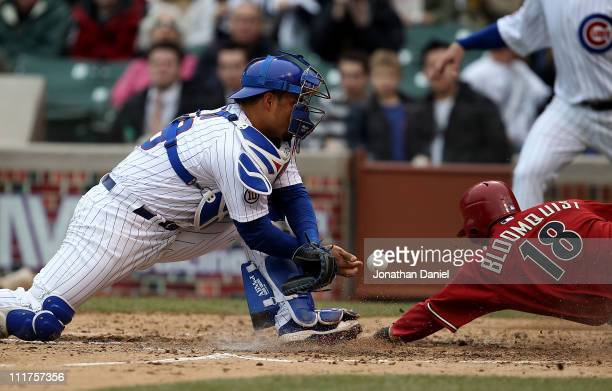 Geovany Soto of the Chicago Cubs drops the ball for an error as Willie Bloomquist of the Arizona Diamondbacks slides in to score in the 5th inning at...