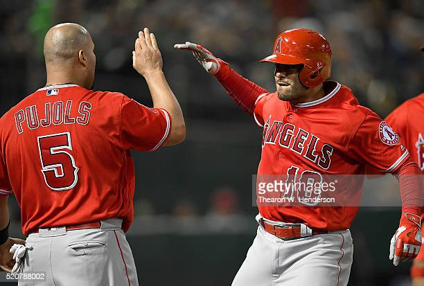 Geovany Soto of the Los Angeles Angels of Anaheim is congratulated by Albert Pujols after Soto hit a tworun homer against the Oakland Athletics in...