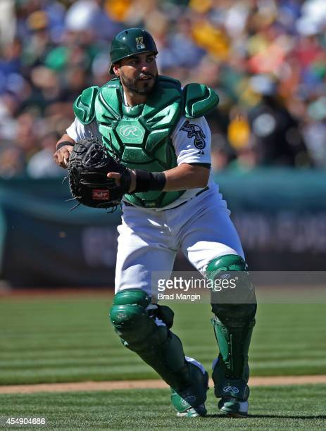 Geovany Soto of the Oakland Athletics makes a play on a bunt against the Houston Astros during the game at Oco Coliseum on Sunday September 7 2014 in...