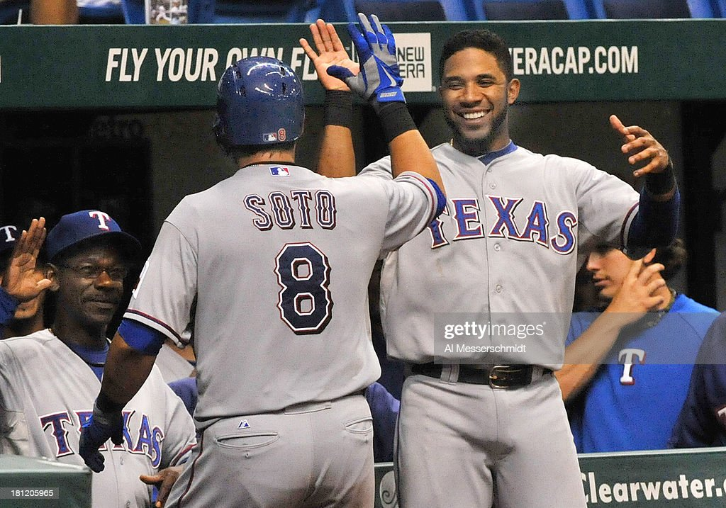 <a gi-track='captionPersonalityLinkClicked' href=/galleries/search?phrase=Geovany+Soto&family=editorial&specificpeople=743668 ng-click='$event.stopPropagation()'>Geovany Soto</a> #8 of the Texas Rangers celebrates his eighth-inning home run with <a gi-track='captionPersonalityLinkClicked' href=/galleries/search?phrase=Elvis+Andrus&family=editorial&specificpeople=4845974 ng-click='$event.stopPropagation()'>Elvis Andrus</a> #1 against the Tampa Bay Rays September 19, 2013 at Tropicana Field in St. Petersburg, Florida. Texas won 8 - 2.
