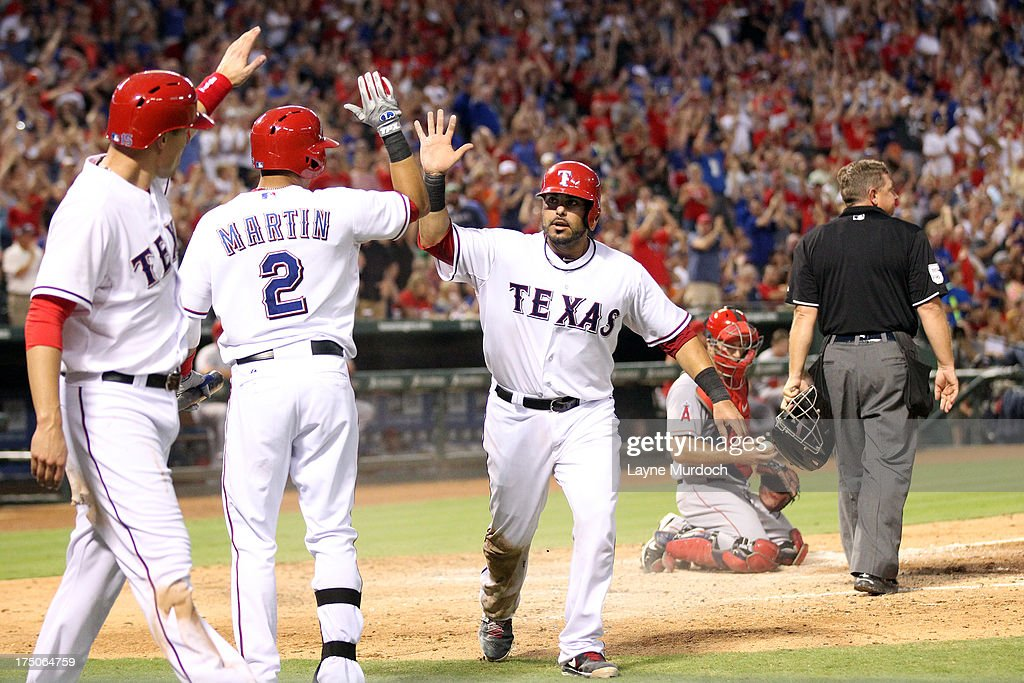 <a gi-track='captionPersonalityLinkClicked' href=/galleries/search?phrase=Geovany+Soto&family=editorial&specificpeople=743668 ng-click='$event.stopPropagation()'>Geovany Soto</a> #8 of the Texas Rangers is congratulated by teammate Leonys Martin #2 of the Los Angeles Angels of Anaheim awaits the throw on July 30, 2013 at the Rangers Ballpark in Arlington in Arlington, Texas.