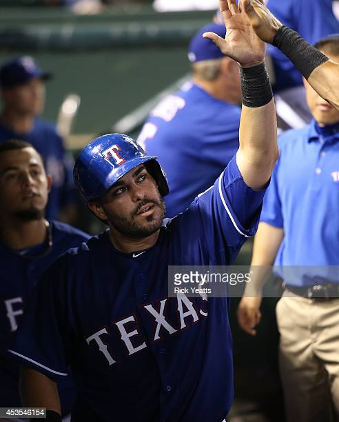 Geovany Soto of the Texas Rangers is congratulated for scoring in the seventh inning to tie the game against the Tampa Bay Rays at Globe Life Park in...