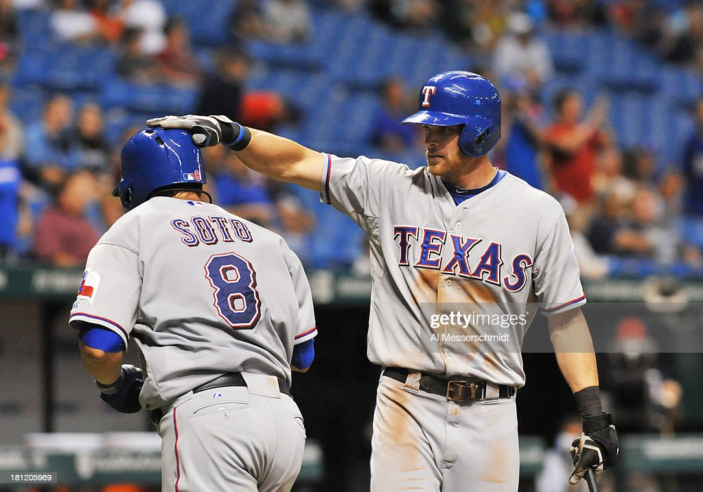 <a gi-track='captionPersonalityLinkClicked' href=/galleries/search?phrase=Geovany+Soto&family=editorial&specificpeople=743668 ng-click='$event.stopPropagation()'>Geovany Soto</a> #8 of the Texas Rangers is congratulated on his eighth-inning home run by <a gi-track='captionPersonalityLinkClicked' href=/galleries/search?phrase=Craig+Gentry&family=editorial&specificpeople=6352553 ng-click='$event.stopPropagation()'>Craig Gentry</a> #23 against the Tampa Bay Rays September 19, 2013 at Tropicana Field in St. Petersburg, Florida. Texas won 8 - 2.