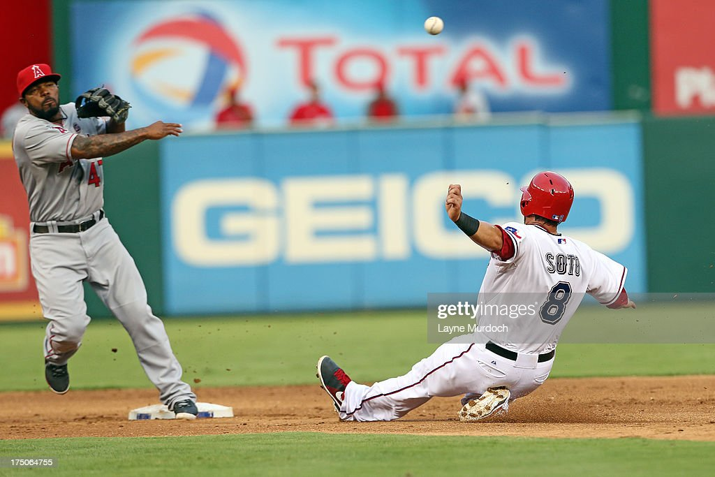 <a gi-track='captionPersonalityLinkClicked' href=/galleries/search?phrase=Geovany+Soto&family=editorial&specificpeople=743668 ng-click='$event.stopPropagation()'>Geovany Soto</a> #8 of the Texas Rangers is forced out at 2nd as Howie Kendick #47 of the Los Angeles Angels of Anaheim makes the throw to 1st base on July 30, 2013 at the Rangers Ballpark in Arlington in Arlington, Texas.
