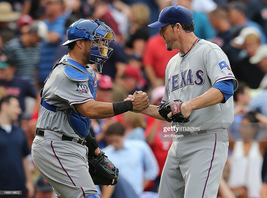 <a gi-track='captionPersonalityLinkClicked' href=/galleries/search?phrase=Geovany+Soto&family=editorial&specificpeople=743668 ng-click='$event.stopPropagation()'>Geovany Soto</a> #8 of the Texas Rangers shakes hands with <a gi-track='captionPersonalityLinkClicked' href=/galleries/search?phrase=Joe+Nathan&family=editorial&specificpeople=215405 ng-click='$event.stopPropagation()'>Joe Nathan</a> #36 after defeating the the Boston Red Sox.10-9. at Fenway Park August 8, 2012 in Boston, Massachusetts.