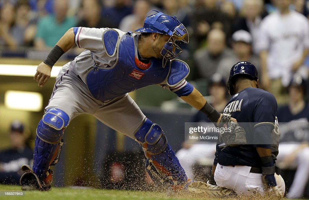 Geovany Soto #8 of the Texas Rangers tags out Jean Segura #9 of the Milwaukee Brewers while sliding into home plate in the bottom of the third inning at Miller Park on May 08, 2013 in Milwaukee, Wisconsin.
