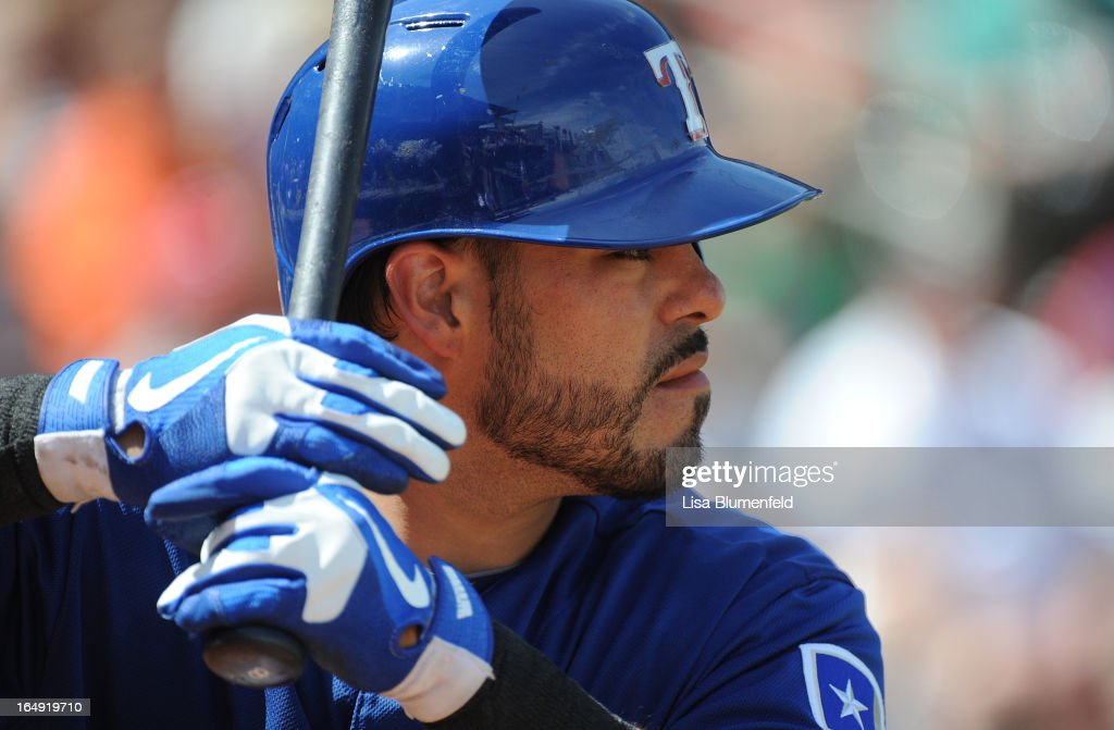 <a gi-track='captionPersonalityLinkClicked' href=/galleries/search?phrase=Geovany+Soto&family=editorial&specificpeople=743668 ng-click='$event.stopPropagation()'>Geovany Soto</a> #8 of the Texas Rangers waits on deck during the game against the Chicago White Sox at Surprise Stadium on March 26, 2013 in Surprise, Arizona.