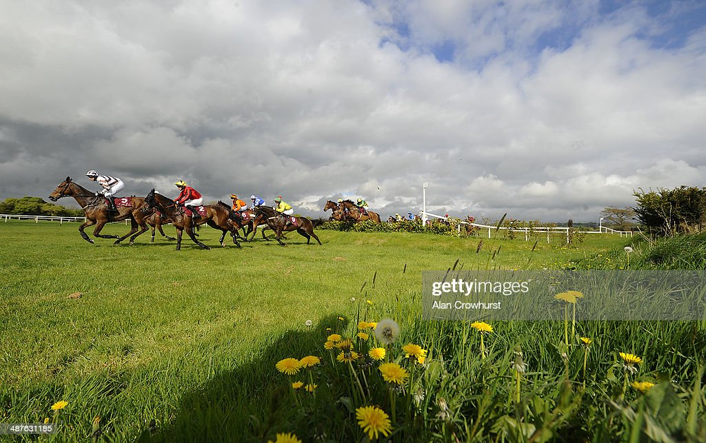 Ger Fox riding Jacks Island (C, yellow) clear the Galway Double before winning The Avon Ri Corporate & Leisure Resort Chase For The La Touche Cup at Punchestown racecourse on May 01, 2014 in Naas, Ireland.
