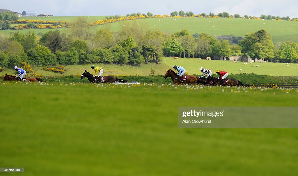 Ger Fox riding Jacks Island (2L) make their way across the centre of the course before winning The Avon Ri Corporate & Leisure Resort Chase For The La Touche Cup at Punchestown racecourse on May 01, 2014 in Naas, Ireland.