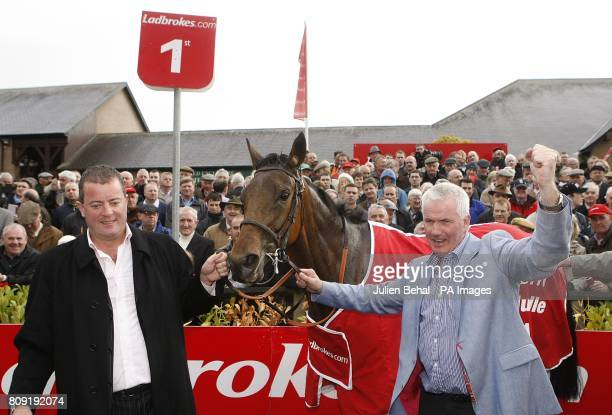 Ger O'Brien and Sean Deane celebrate winning the Ladbrokescom World Series Hurdle with Quevega