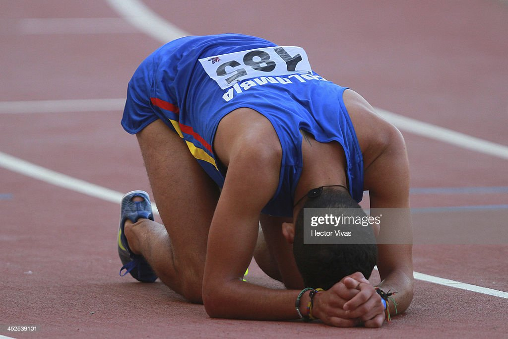 Gerad Giraldo of Colombia lies exahusted on the ground after men's 3,000m steeplechase final as part of the XVII Bolivarian Games Trujillo 2013 at Chan Chan Stadium on November 29, 2013 in Trujillo, Peru.