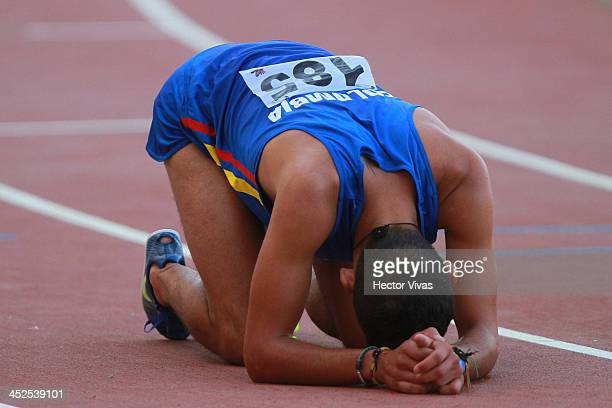 Gerad Giraldo of Colombia lies exahusted on the ground after men's 3000m steeplechase final as part of the XVII Bolivarian Games Trujillo 2013 at...