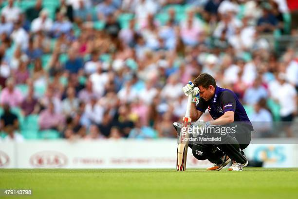 Geraint Jones of Gloucestershire looks on in discomfort after being hit by the ball during the Natwest T20 Blast match between Surrey and...