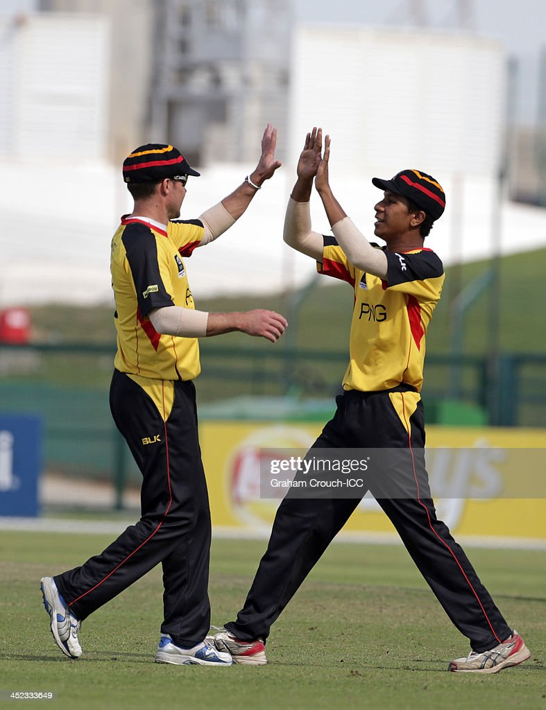 <a gi-track='captionPersonalityLinkClicked' href=/galleries/search?phrase=Geraint+Jones&family=editorial&specificpeople=171413 ng-click='$event.stopPropagation()'>Geraint Jones</a> (left) of PNG celebrates a dismissal during the Quarter Final match 64 between Papua New Guinea and Hong Kong at the ICC World Twenty20 Qualifiers at the Zayed Cricket Stadium on November 28, 2013 in Abu Dhabi, United Arab Emirates.