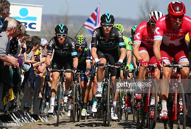 Geraint Thomas and Luke Rowe of Great Britain and Sky ride up the Oude Kwaremont during the 100th edition of the Tour of Flanders from Bruges to...