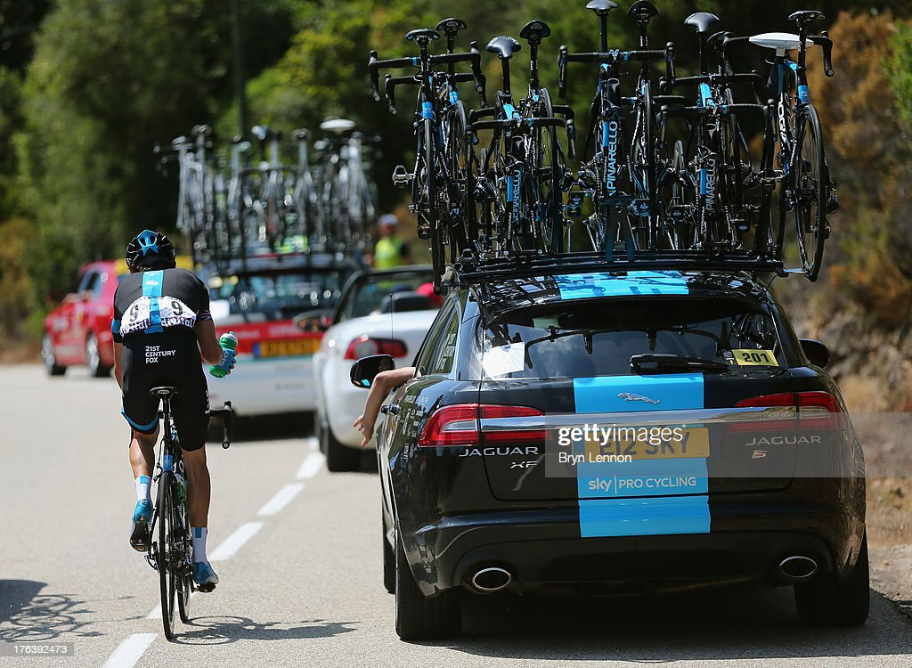 Geraint Thomas of Great Britain and SKY Procycling collects bottles from his team car during stage three of the 2013 Tour de France, a 145.5KM road stage from Ajaccio to Calvi, on July 1, 2013 in Calvi, France.