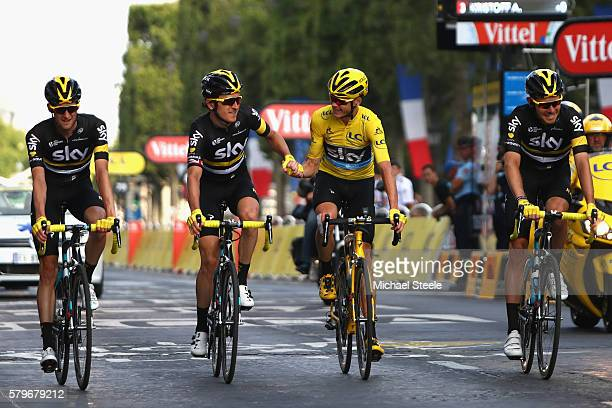 Geraint Thomas of Great Britain and Team Sky and Wout Poels of the Netherlands and Team Sky congratulate Chris Froome of Great Britain and Team Sky...