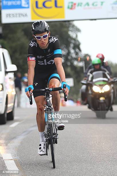 Geraint Thomas of Great Britain and Team Sky crosses the finishing line losing 34 places in the general classification after crashing during stage 7...