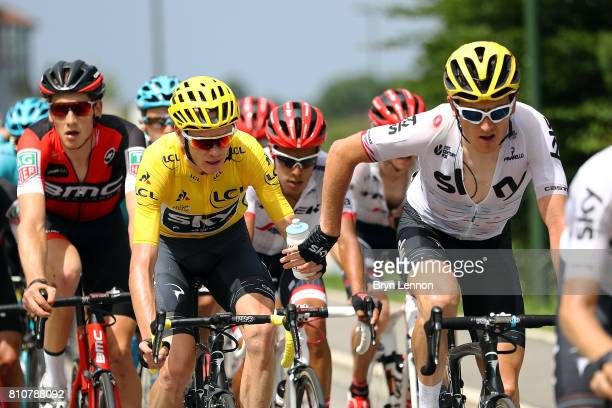 Geraint Thomas of Great Britain and Team SKY hands race leader and team mate Chris Froome a water bottle during stage eight of the 2017 Tour de...