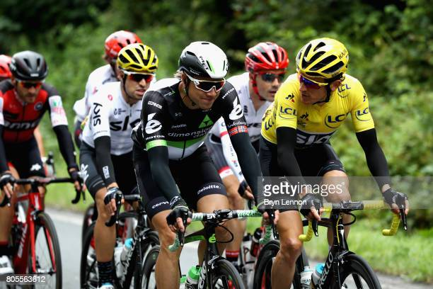 Geraint Thomas of Great Britain and Team Sky talks with Edvald Boasson Hagen of Norway and Team Dimension Data during stage two of the 2017 Tour de...