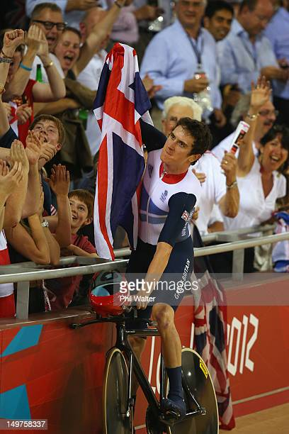 Geraint Thomas of Great Britain celebrates with a Union Jack after winning gold and setting a new world record in the Men's Team Pursuit Track...