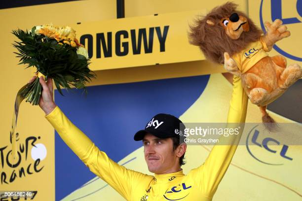Geraint Thomas of Great Britain riding for Team Sky in the yellow leader's jersey poses for a photo on the podium after stage three of the 2017 Le...