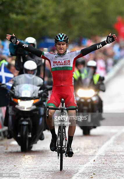 Geraint Thomas of Wales celebrates as he crosses the finish line during the Men's Cycling Road Race during day eleven of the Glasgow 2014...
