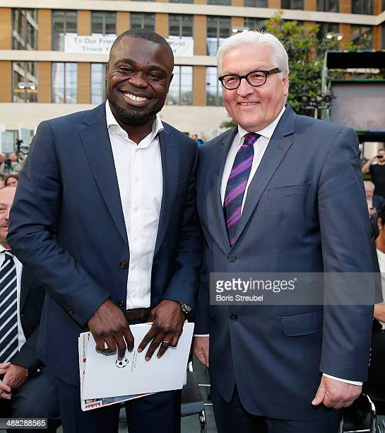 Gerald Asamoah and Foreign minister FrankWalter Steinmeier pose during the German Football Ambassador 2014 Award ceremony at The Federal Foreign...