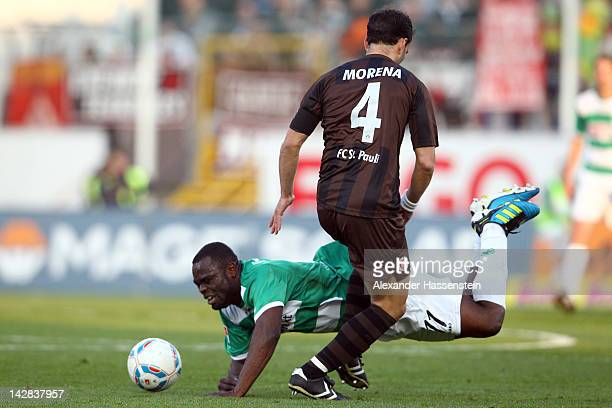 Gerald Asamoah of Fuerth battles for the ball with Fabio Moreno of Hamburg during the Second Bundesliga match between Greuther Fuerth and FC St Pauli...