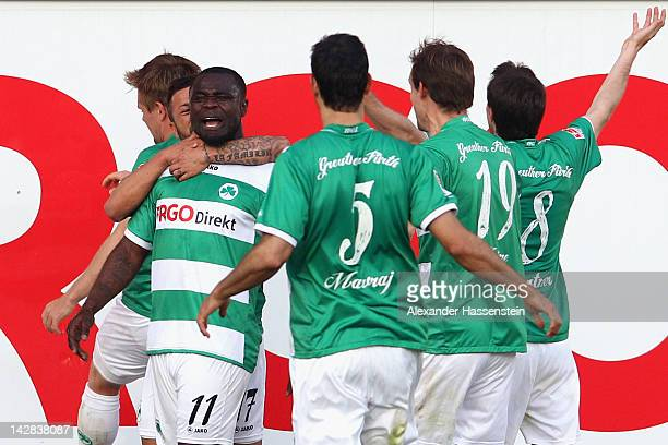 Gerald Asamoah of Fuerthcelebrates scoring the 2nd team goal with his team mates during the Second Bundesliga match between Greuther Fuerth and FC St...