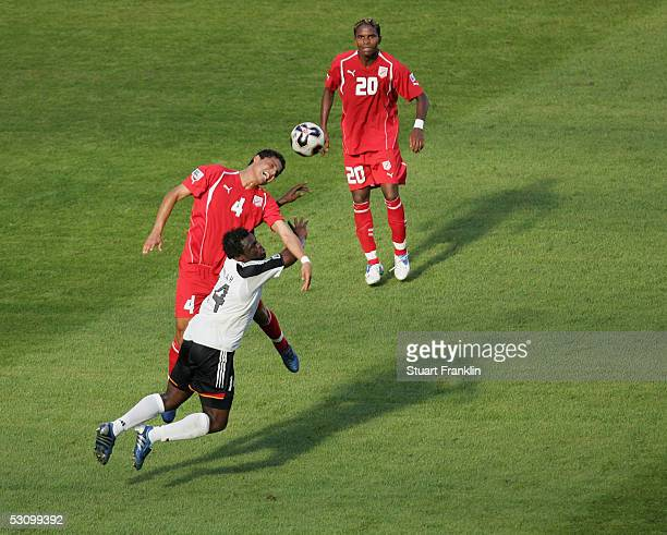 Gerald Asamoah of Germany in action with Wissem Abdi and Clayton of Tunisia during The FIFA Confederations Cup Match between Tunisia and Germany at...