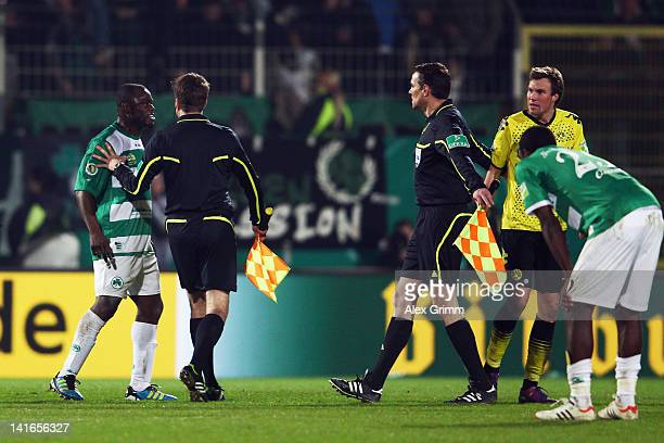 Gerald Asamoah of Greuther Fuerth argues with Kevin Grosskreutz of Dortmund after the DFB Cup semi final match between SpVgg Greuther Fuerth and...