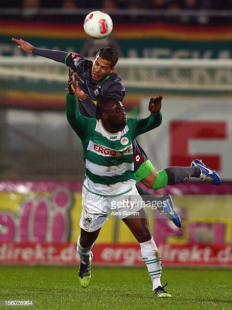 Gerald Asamoah of Greuther Fuerth is challenged by Alvaro Dominguez Soto during the Bundesliga match between SpVgg Greuther Fuerth and Borussia...