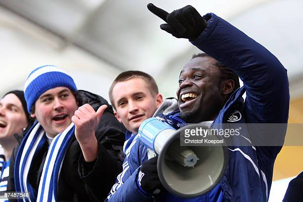 Gerald Asamoah of Schalke celebrates the 41 victory after the Bundesliga match between Eintracht Frankfurt and FC Schalke at the Commerzbank Arena on...