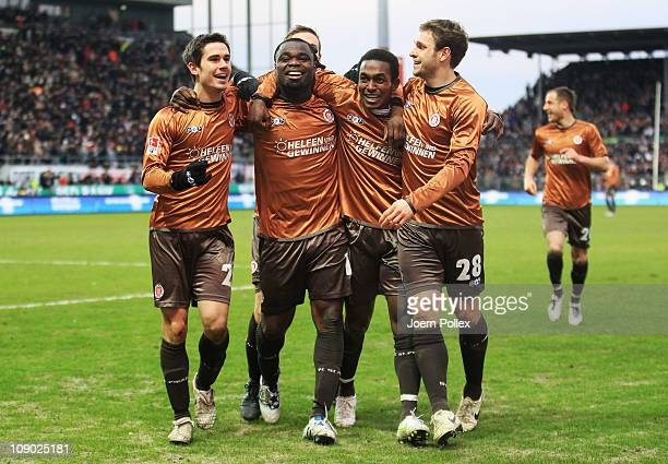 Gerald Asamoah of StPauli celebrates with his team mates after scoring his team's second goal during the Bundesliga match between FC StPauli and...
