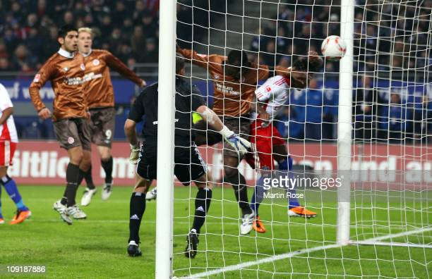 Gerald Asamoah of StPauli head's his team's opening goal during the Bundesliga match between Hamburger SV and FC StPauli at Imtech Arena on February...