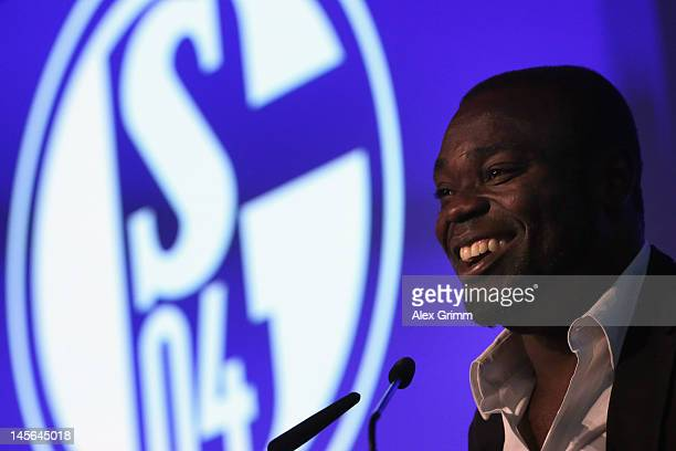 Gerald Asamoah reacts after being awarded member of the Schalke 'Hall of fame' during the annual meeting of FC Schalke 04 at Emscher Lippe Halle on...