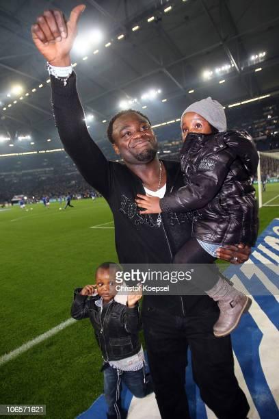 Gerald Asamoah says farewell to the Schalke fans before the Bundesliga match between FC Schalke 04 and FC St Pauli at Veltins Arena on November 5...