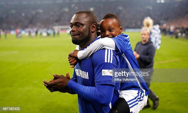 Gerald Asamoah with son will be honored after the Gerald Asamoah's Farewell Match at VeltinsArena on November 14 2015 in Gelsenkirchen Germany