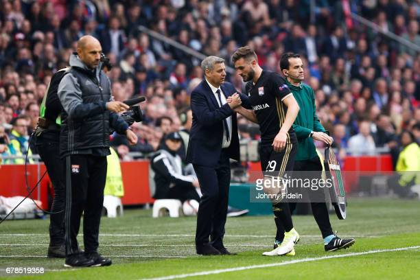 Gerald Baticle Bruno Genesio head coach and Lucas Tousart of Lyon during the Uefa Europa League semi final first leg match between Ajax Amsterdam and...